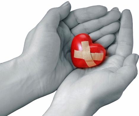 Image result for broken heart in hands