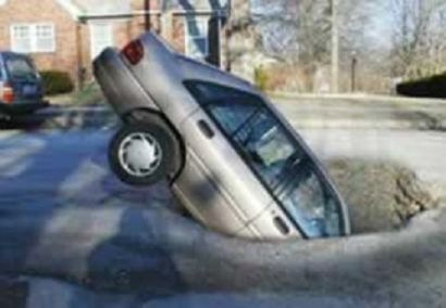 Car in Pothole
