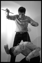 Man controlling man